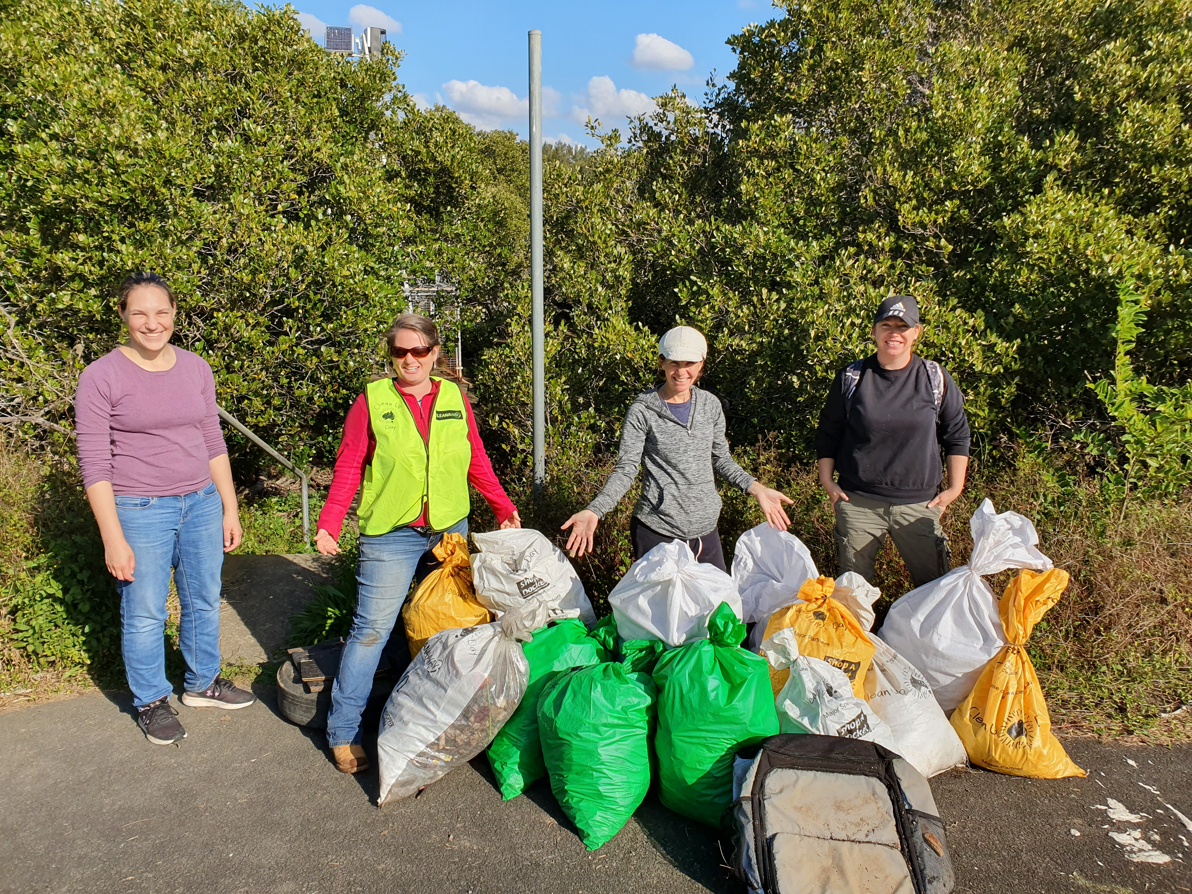 Volunteers with bags of rubbish at Clean Up Australia