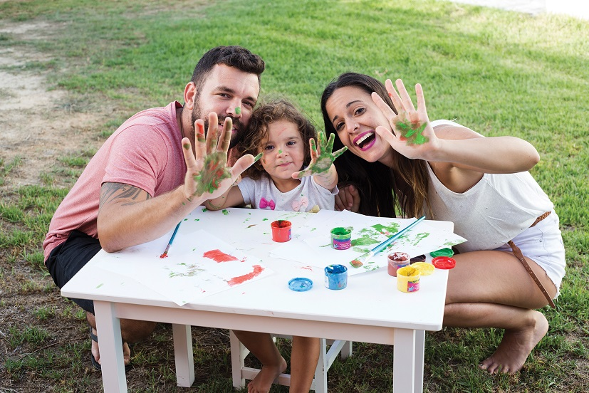 Image of a young family doing arts and craft