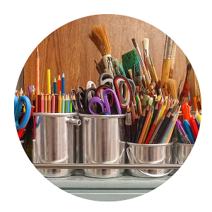 Image of colouring pencils and paint brushes used for craft