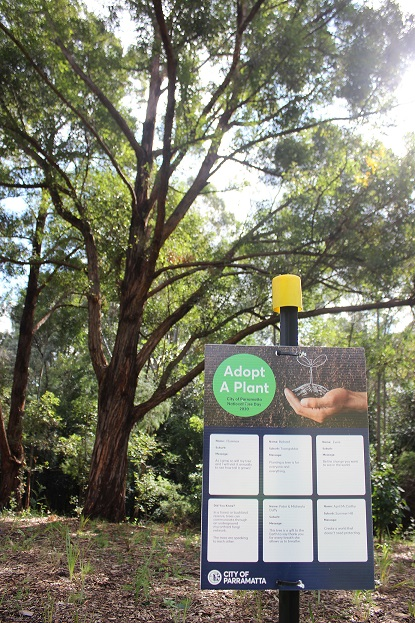 Sign displaying community messages at the national Tree Day site