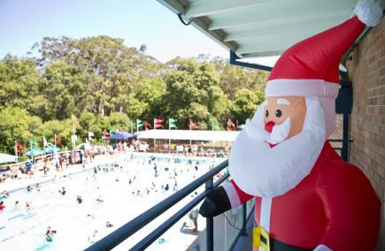 Inflatable Santa looking over the swimming pool