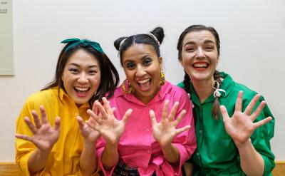 Image of three performers taking part in the Spot On Children's Festival smiling at the camera