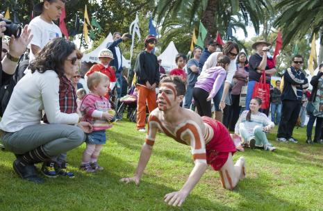 Families at Burramatta NAIDOC with small toddler interaction
