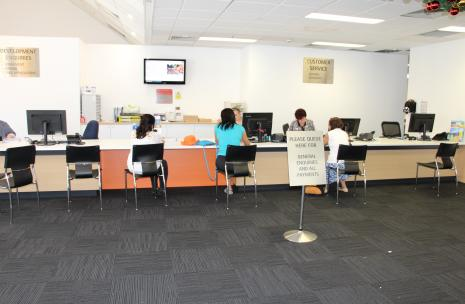 A view of the Customer Contact Centre with clients sitting down in chairs