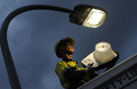 Man installing street light