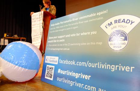 Our living river forum with person standing a podium