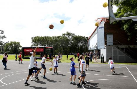 Children shooting hoops at the West Epping Park Basketball Court