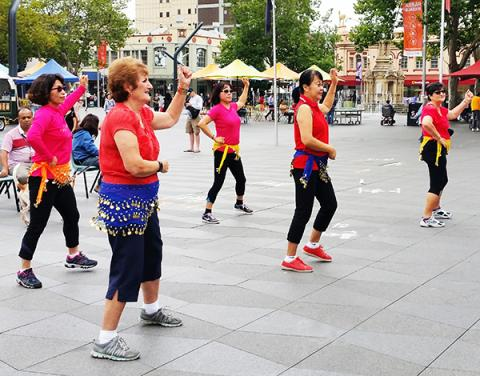 Over 55's enjoying belly-dancing in Parramatta Square